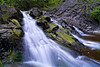 An un-named three fingered waterfall tumbles down the lower part of Amity Creek in the evening.  1/2