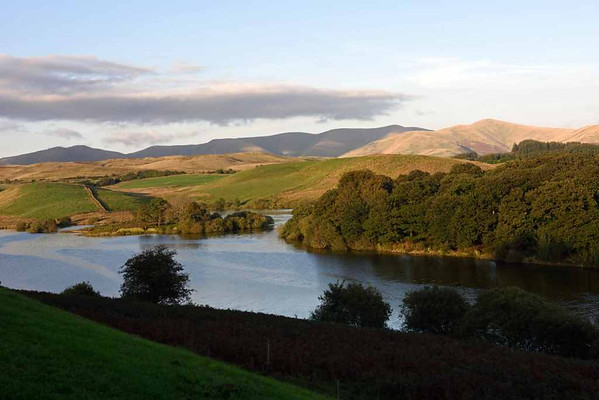 Killington lake, 17 September 2016 1.  Looking north east towards the Howgills.  The lake is a reservoir built by the Lancaster Canal in 1819 to supply water to the canal.  It became railway property after the London & North Western Railway bought the canal in 1885.
