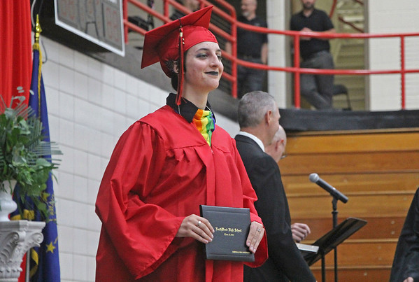 Gabriella Anderson poses, diploma in hand, during NorthWood High School's 2021 graduation ceremony in the school's gym in Nappanee on Friday.