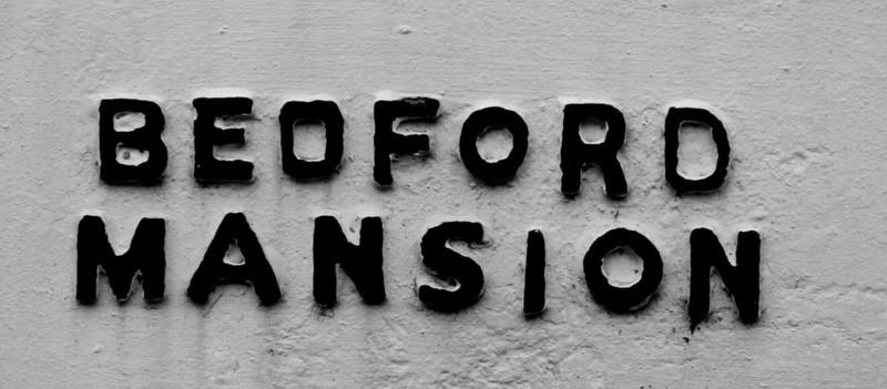 Concrete sign, Bedford Mansion, Derngate. Northampton