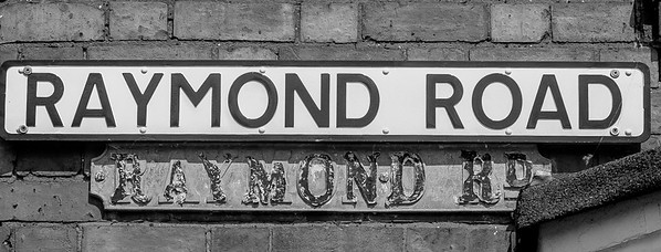 Competing street signs, Raymond Road, Northampton
