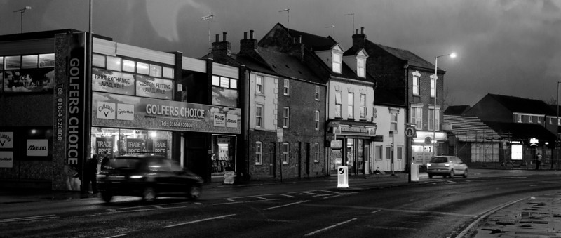 Barrack Road at night , Northampton, looking towards town. Mostly C19 buildings with some newer accretions..