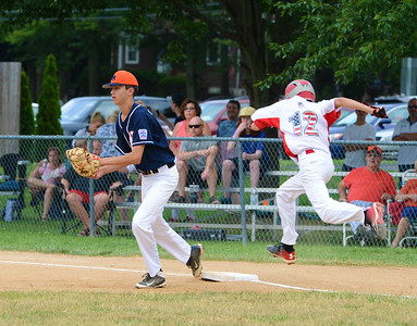 Sean Slowinski (16) gets throw in time to nip Billy Loughnana (12) at first base.