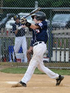 Ryan Bauerle (29) follows through with swing.