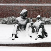 "Tewksbury snow features. Mico Kaufman's ""Water"" sculpture of Anne Sullivan and Helen Keller, at Tewksbury Town Hall. only partially covered early in snowstorm. (SUN/Julia Malakie)"