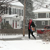 Billerica snow features. Pedestrian on Concord Road in early stage of storm Tuesday morning. (SUN/Julia Malakie)