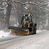 Billerica snow features. Plow on High Street in early stage of storm Tuesday morning. (SUN/Julia Malakie)