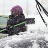 Chelmsford snow features. Patricia Konadu of Lowell, who works at the Hannaford supermarket at Drum Hill, cleans off her car after work. (SUN/Julia Malakie)