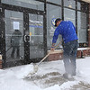 Chelmsford snow features. Dave Mansfield, general manager of ChoiceFitness in Chelmsford Town Center, shovels the front walk just before closing early at 1pm. (SUN/Julia Malakie)