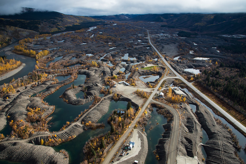 Aerial photography of Dawson City, Yukon. Also features the Yukon and Klondike Rivers, placer gold mining and dredge piles.
