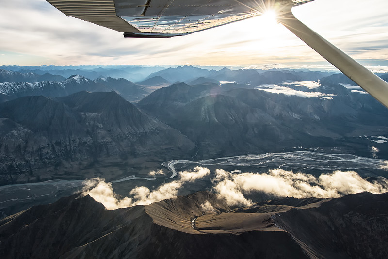 Clouds and mountains above the Snake River in the Yukon's largest wilderness area North of Dawson City.