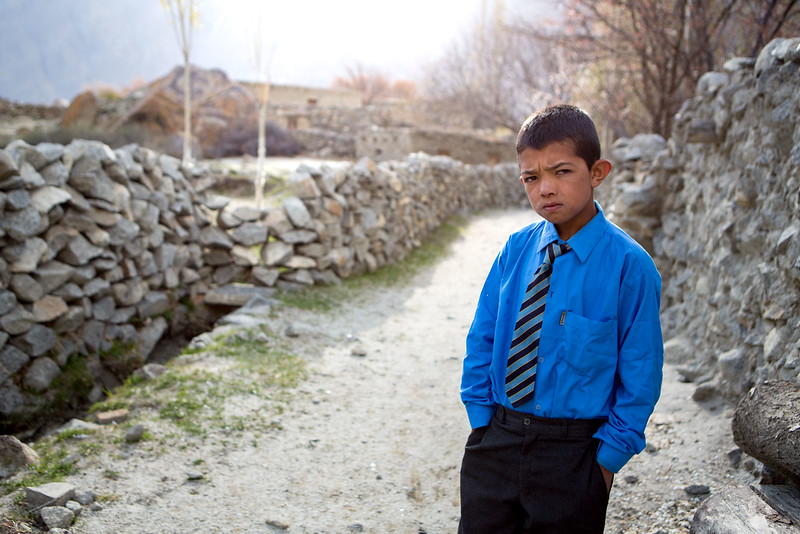 Boy, ready to go to school. Gulmit. Hunza.
