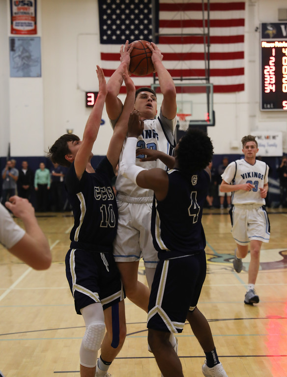 . Pleasant Valley High\'s Kevin Kremer (22) goes up for a shot against Central Catholic High\'s Justin Traina (10) and Joshua Hamilton (4), March 17, 2018, in Chico, California. (Carin Dorghalli -- Enterprise-Record)