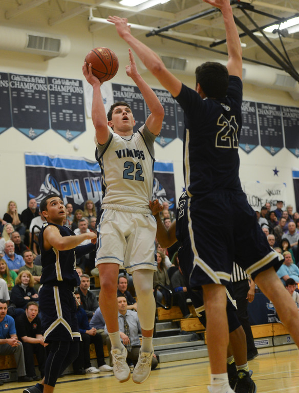 . Pleasant Valley High\'s Kevin Kremer (22) goes up for a shot against Central Catholic High\'s Nic Sani (21) during the Northern California Championship game, March 17, 2018, in Chico, California. (Carin Dorghalli -- Enterprise-Record)