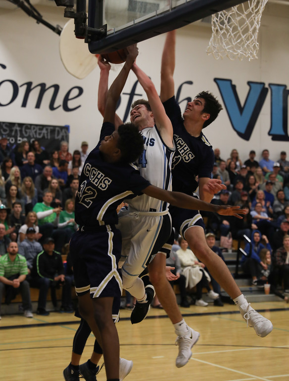 . Pleasant Valley High\'s Cody Hamilton (24) goes up for a shot against Central Catholic High\'s Myles Clayton (32) and Nic Sani (21) during the Northern California Championship game, March 17, 2018, in Chico, California. (Carin Dorghalli -- Enterprise-Record)