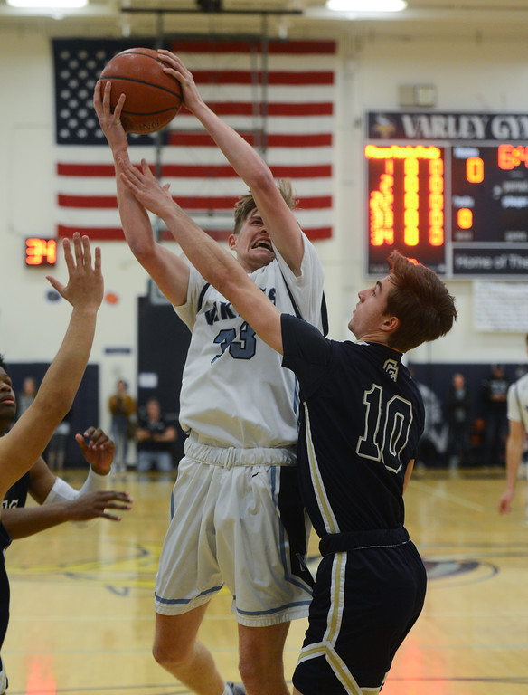 . Pleasant Valley High\'s Jake Rick (33) goes up for a shot against Central Catholic High\'s Justin Traina (10) during the Northern California Championship game, March 17, 2018, in Chico, California. (Carin Dorghalli -- Enterprise-Record)