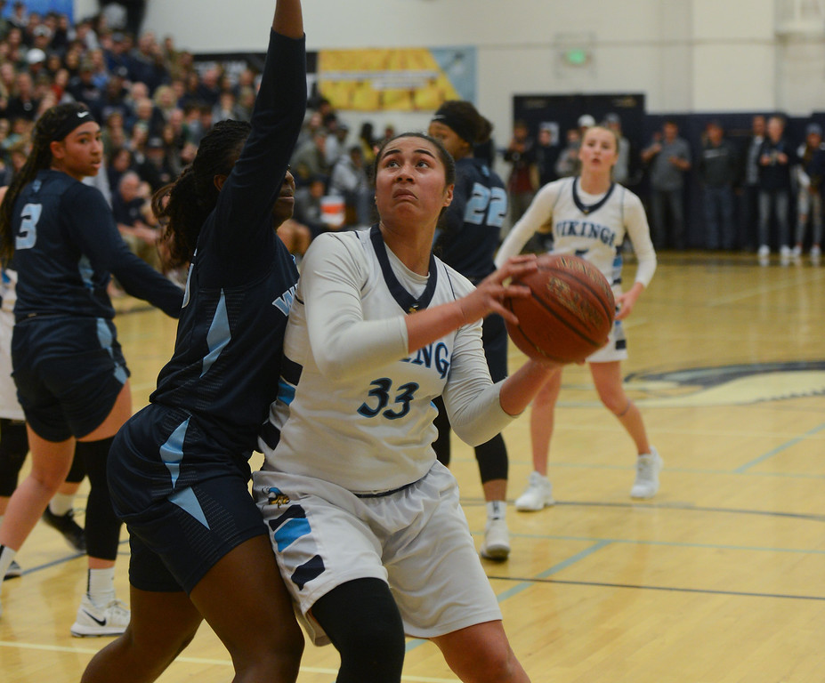 . Pleasant Valley High\'s Sirena Tuitele (33) goes up for a shot against Valley Christian\'s Jade Butler (35) during the Northern California Championship game, March 17, 2018, in Chico, California. (Carin Dorghalli -- Enterprise-Record)