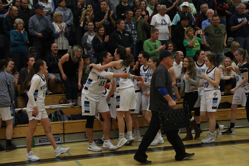 . Pleasant Valley High\'s Sirena Tuitele and Makenna Joyce hug each other to celebrate their win against Valley Christian High, March 17, 2018, in Chico, California. (Carin Dorghalli -- Enterprise-Record)