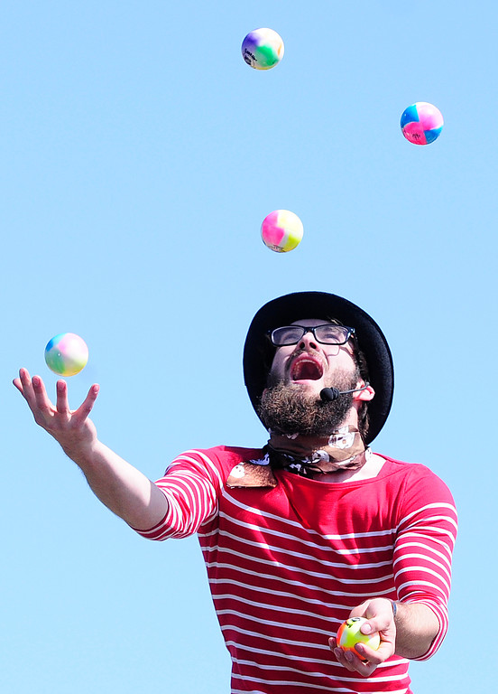 . VALLEJO, CA - JUNE 16, Jonathan Kondor of the Kondor Brothers juggles on the Treasure Island Stage during the Northen California Pirate Festival along the waterfront in Vallejo on Saturday.. (CHRIS RILEY/TIMES-HERALD)