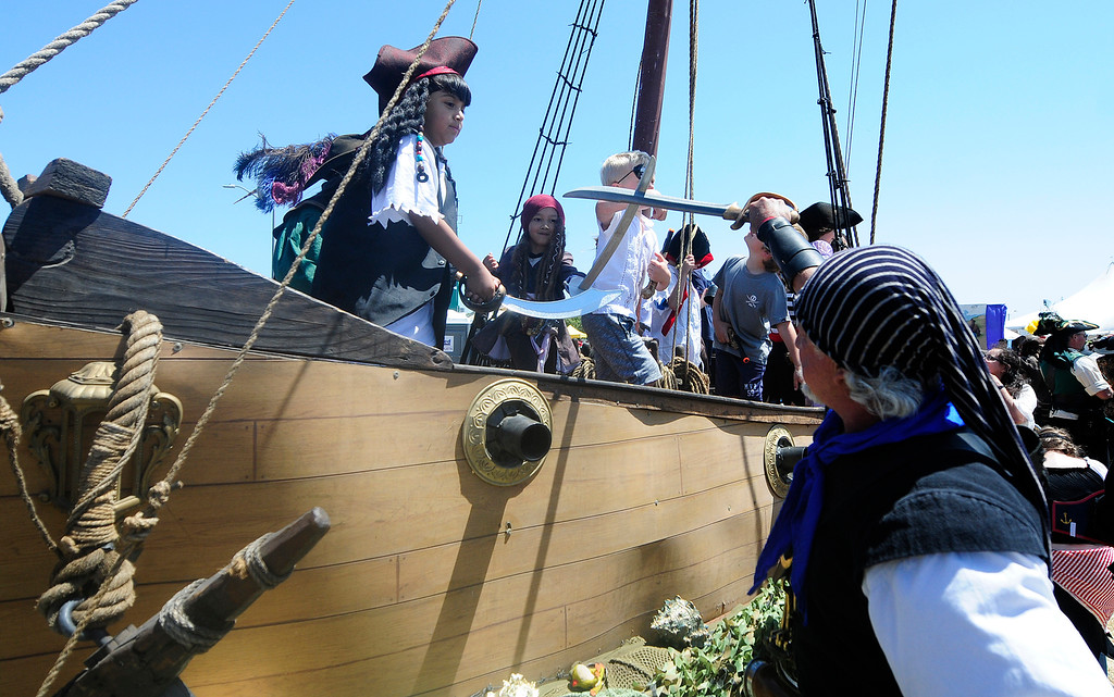 . VALLEJO, CA - JUNE 16, Steve Guzman of Alturas sword fights with Dominic Bura, 5, of San Bruno, and other young pirates in the deck of a ship during the Northen California Pirate Festival along the waterfront in Vallejo on Saturday. (CHRIS RILEY/TIMES-HERALD)