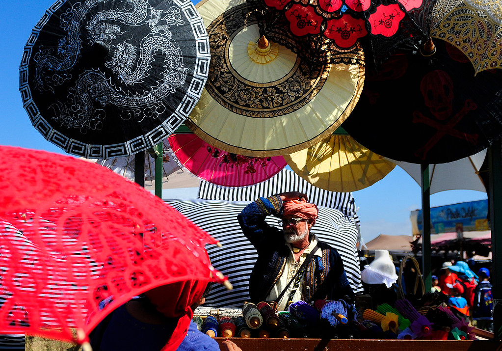 . VALLEJO, CA - JUNE 16, Peter Dippell, of Redlands, sells shade on a stick during the Northen California Pirate Festival along the waterfront in Vallejo on Saturday. (CHRIS RILEY/TIMES-HERALD)