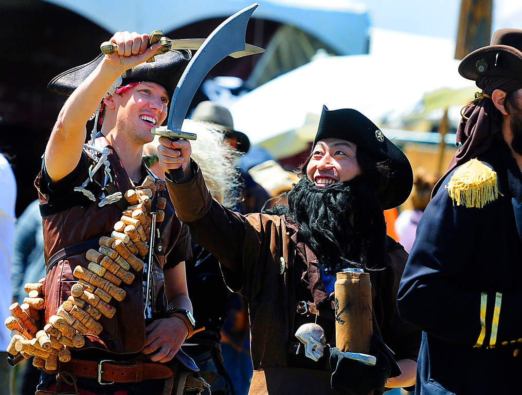 . VALLEJO, CA - JUNE 16, Kaptain Kosuke Iwai sword fights with Pirate Phil Gach, both from Santa Cruz, as they enjoy the Northern California Pirate Festival on Saturday along the waterfront in Vallejo. the Festival continues on Sunday. (CHRIS RILEY/TIMES-HERALD)