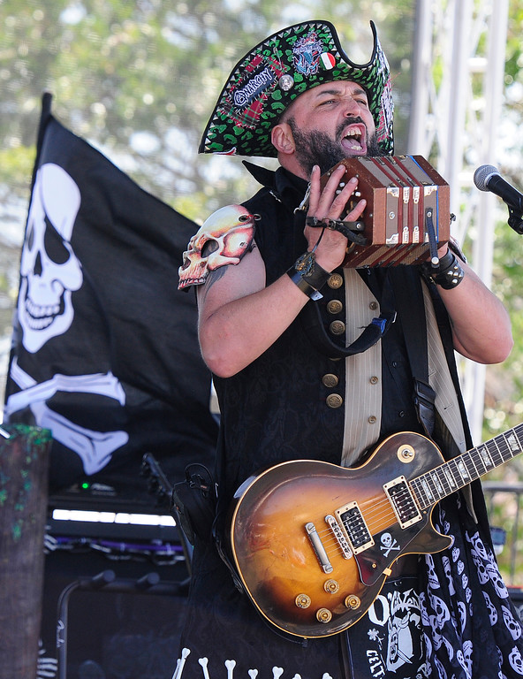 . VALLEJO, CA - JUNE 16, John Cloud, known as Captain Cloud plays the concertina with the band O\'Craven during the Northen California Pirate Festival along the waterfront in Vallejo on Saturday. (CHRIS RILEY/TIMES-HERALD)