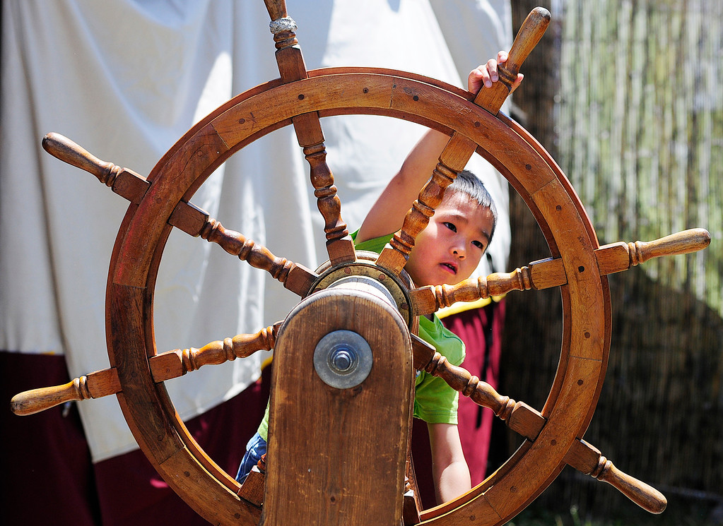 . VALLEJO, CA - JUNE 16, A young pirate steers the wheel of a ship during the Northen California Pirate Festival along the waterfront in Vallejo on Saturday. (CHRIS RILEY/TIMES-HERALD)