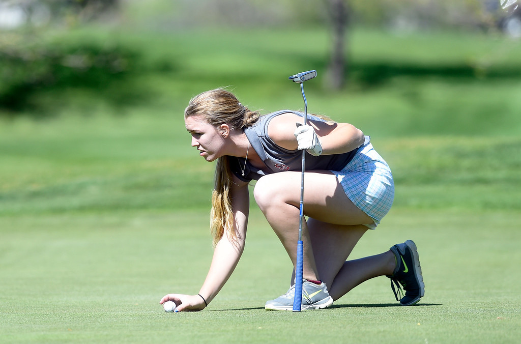 . Silver Creek High School\'s Kendra Green eyes her putt during the first-round of the Northern League Golf Tournament on Wednesday at the Indian Peaks Golf Course in Lafayette. More photos: www.BoCoPreps.com Jeremy Papasso/ Staff Photographer/ April 19, 2017