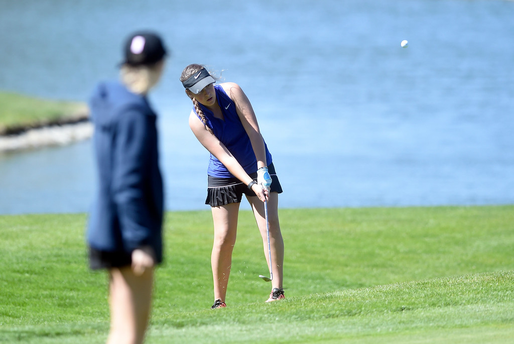 . Mountain View High School\'s Katie Haag chips the ball during the first-round of the Northern League Golf Tournament on Wednesday at the Indian Peaks Golf Course in Lafayette. More photos: www.BoCoPreps.com Jeremy Papasso/ Staff Photographer/ April 19, 2017