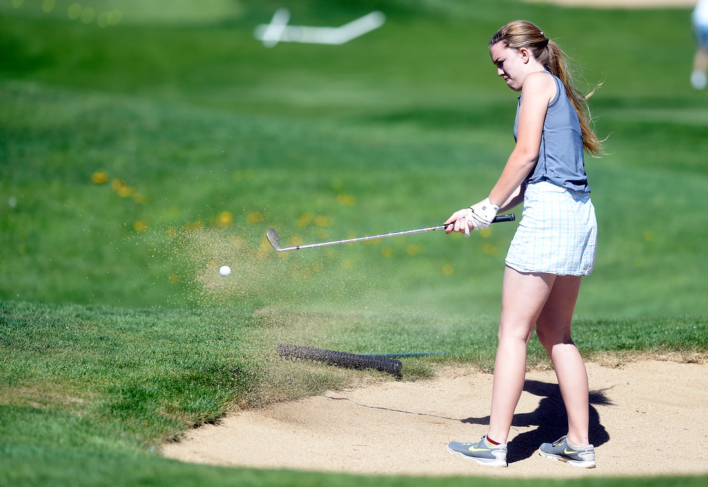 . Silver Creek High School\'s Kendra Green hits out of the sand during the first-round of the Northern League Golf Tournament on Wednesday at the Indian Peaks Golf Course in Lafayette. More photos: www.BoCoPreps.com Jeremy Papasso/ Staff Photographer/ April 19, 2017