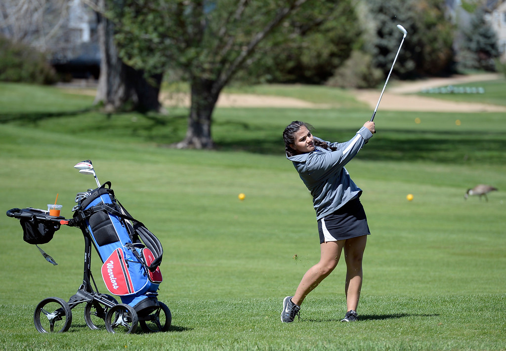 . Centaurus High School\'s Chantelle Humphries hits the ball during the first-round of the Northern League Golf Tournament on Wednesday at the Indian Peaks Golf Course in Lafayette. More photos: www.BoCoPreps.com Jeremy Papasso/ Staff Photographer/ April 19, 2017