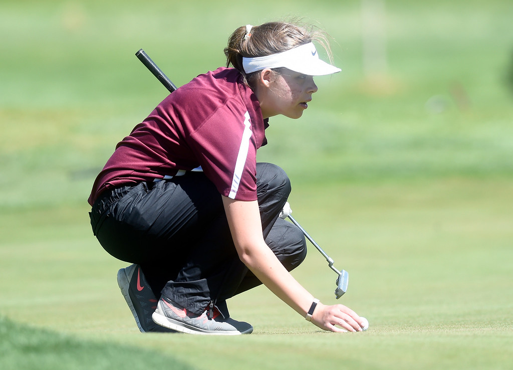 . Silver Creek High School\'s Amelia Haines eyes her putt during the first-round of the Northern League Golf Tournament on Wednesday at the Indian Peaks Golf Course in Lafayette. More photos: www.BoCoPreps.com Jeremy Papasso/ Staff Photographer/ April 19, 2017