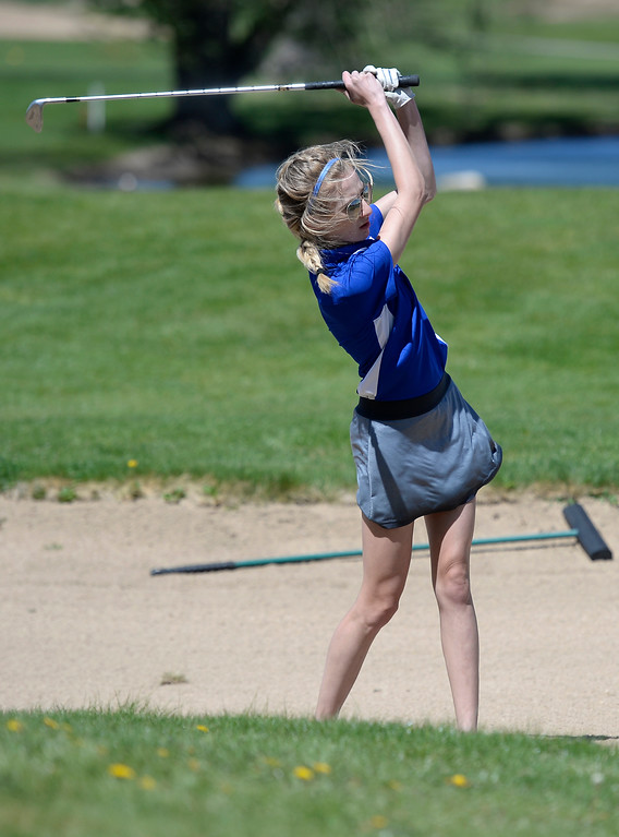 . Centaurus High School\'s Amaya Cox hits out of the sand during the first-round of the Northern League Golf Tournament on Wednesday at the Indian Peaks Golf Course in Lafayette. More photos: www.BoCoPreps.com Jeremy Papasso/ Staff Photographer/ April 19, 2017
