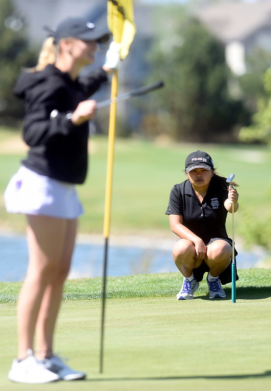 . Niwot High School\'s Mya Ostrom eyes her putt during the first-round of the Northern League Golf Tournament on Wednesday at the Indian Peaks Golf Course in Lafayette. More photos: www.BoCoPreps.com Jeremy Papasso/ Staff Photographer/ April 19, 2017