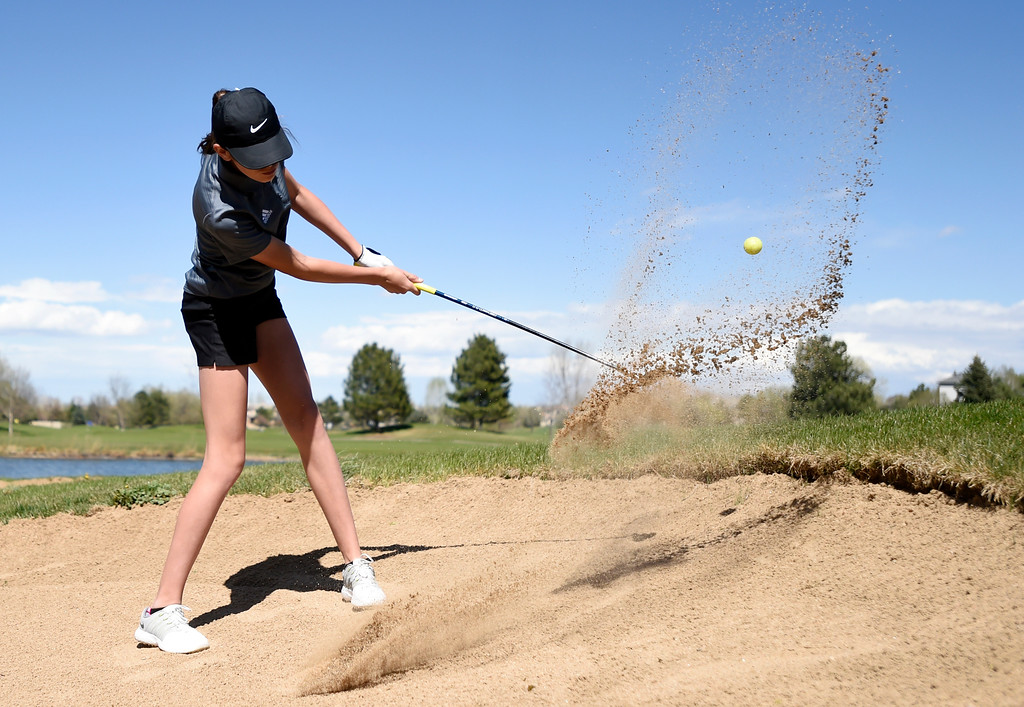 . Mountain View High School\'s Genne Stobbe hits out of a sand bunker during the first-round of the Northern League Golf Tournament on Wednesday at the Indian Peaks Golf Course in Lafayette. More photos: www.BoCoPreps.com Jeremy Papasso/ Staff Photographer/ April 19, 2017