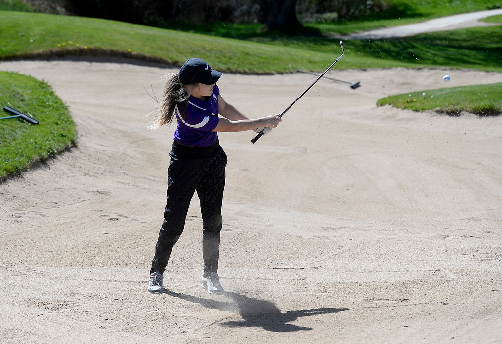 . Mountain View High School\'s Renee Demaree hits ouf of the sand during the first-round of the Northern League Golf Tournament on Wednesday at the Indian Peaks Golf Course in Lafayette. More photos: www.BoCoPreps.com Jeremy Papasso/ Staff Photographer/ April 19, 2017