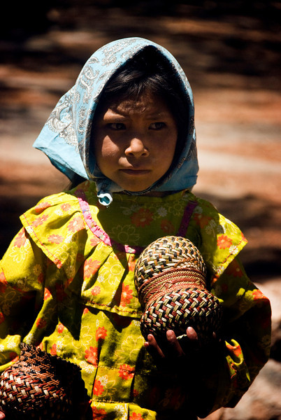 Tarahumara Indian girl with baskets 1