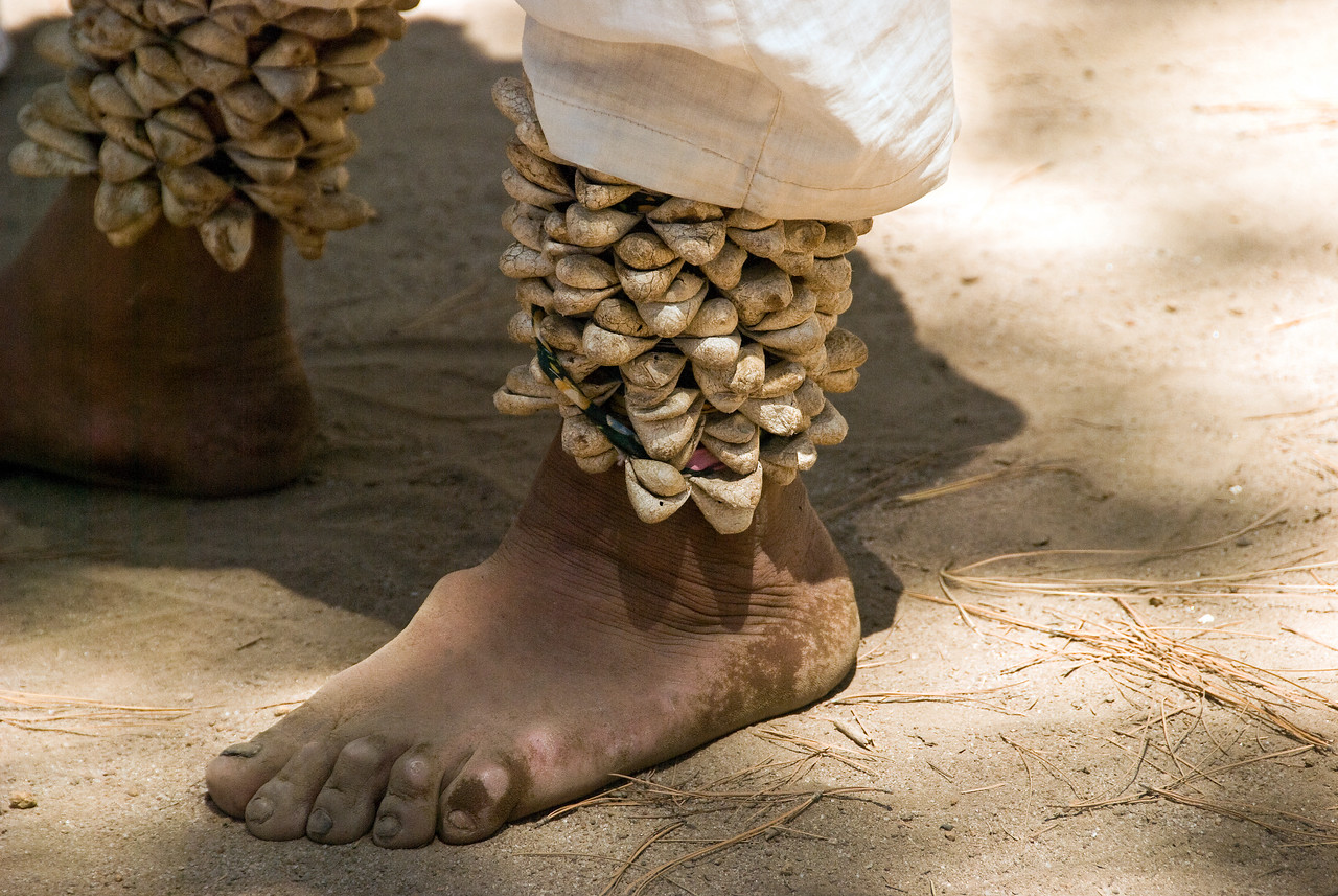 The rattles around the ankles are made from butterfly cocoons which are dried and a pea placed inside to make the rattle sound.