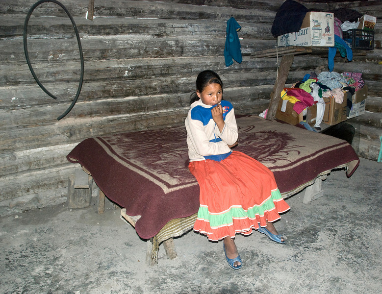 Tarahumara Indian girl in her home