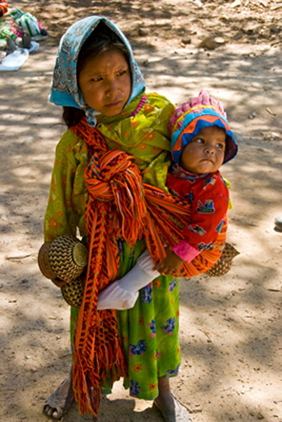 The Tarahumara girls marry when they are 12 or 13.   This is a girl with her baby selling her baskets.