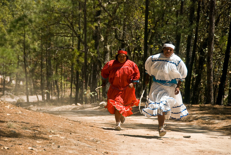 The Tarahumara Indian women play a game where they throw a ball from a device on a stick and throw it as far as they can up the path and return.  The one who throws the farthest over the finish wins the game.