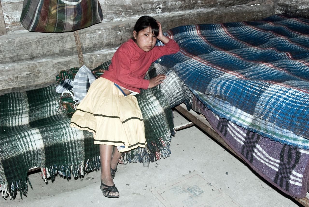 Tarahumara Indian girl on her bed