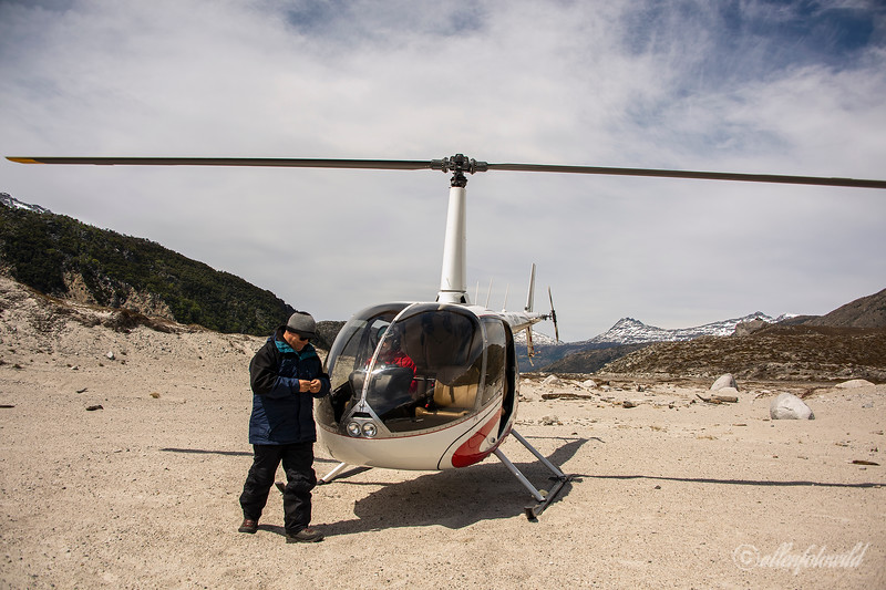 Helicopter, crew and shadow, Glacier Nef terminal moraine, Aysen, Chile