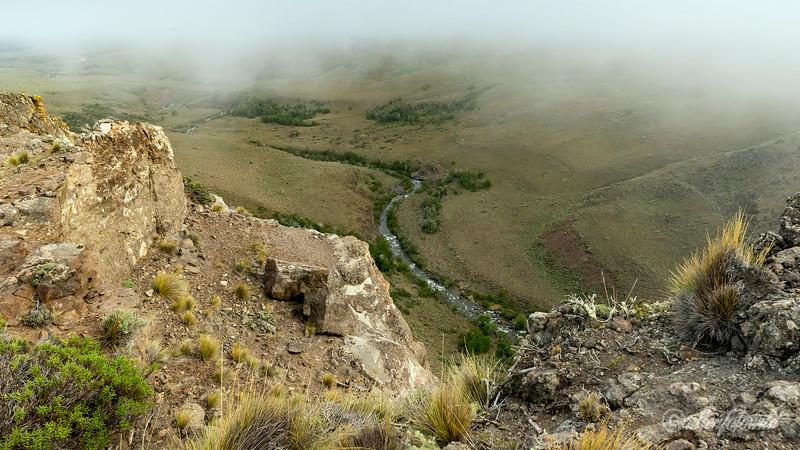 Condor cliffs above the Rio Nireguao O Coichel gorge and rapids, morning fog, Patagonia