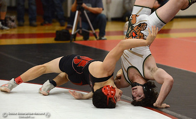 Foothill's Robert Gonzals, left, manages to upend Paradise's Brent Smith, right, during the Northern Section Division I finals Saturday, Feb. 18, 2017, at Chico High in Chico, California. Smith would win the match and the 140-pound title. (Dan Reidel -- Enterprise-Record)