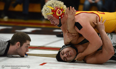 A referee makes sure he has a view of Red Bluff wrestler Marco Ortiz' shoulders, bottom, as Chico's Patrick Whitmore pins him in the Northern Section Division I finals Saturday, Feb. 18, 2017, at Chico High in Chico, California. (Dan Reidel -- Enterprise-Record)