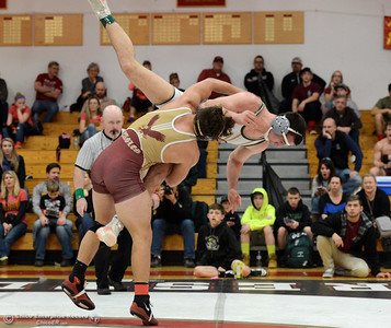 West Valley's Bonofacio Escobar Jr. throws Paradise wrestler Marshall Neumann in the Northern Section Division I finals Saturday, Feb. 18, 2017, at Chico High in Chico, California. (Dan Reidel -- Enterprise-Record)