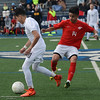 Pleasant Valley High's Ari Reyes (10) and Chico High's Jovani Casillas-Escajeda (14) fight for the ball during the Northern Section Soccer Championship game, Saturday, February 24, 2018, in Chico, California. (Carin Dorghalli -- Enterprise-Record)