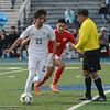 Pleasant Valley High's Thomas Gevers (20) and Chico High's Fernando Palacios (8) chase after the ball during the Northern Section Soccer Championship game, Saturday, February 24, 2018, in Chico, California. (Carin Dorghalli -- Enterprise-Record)